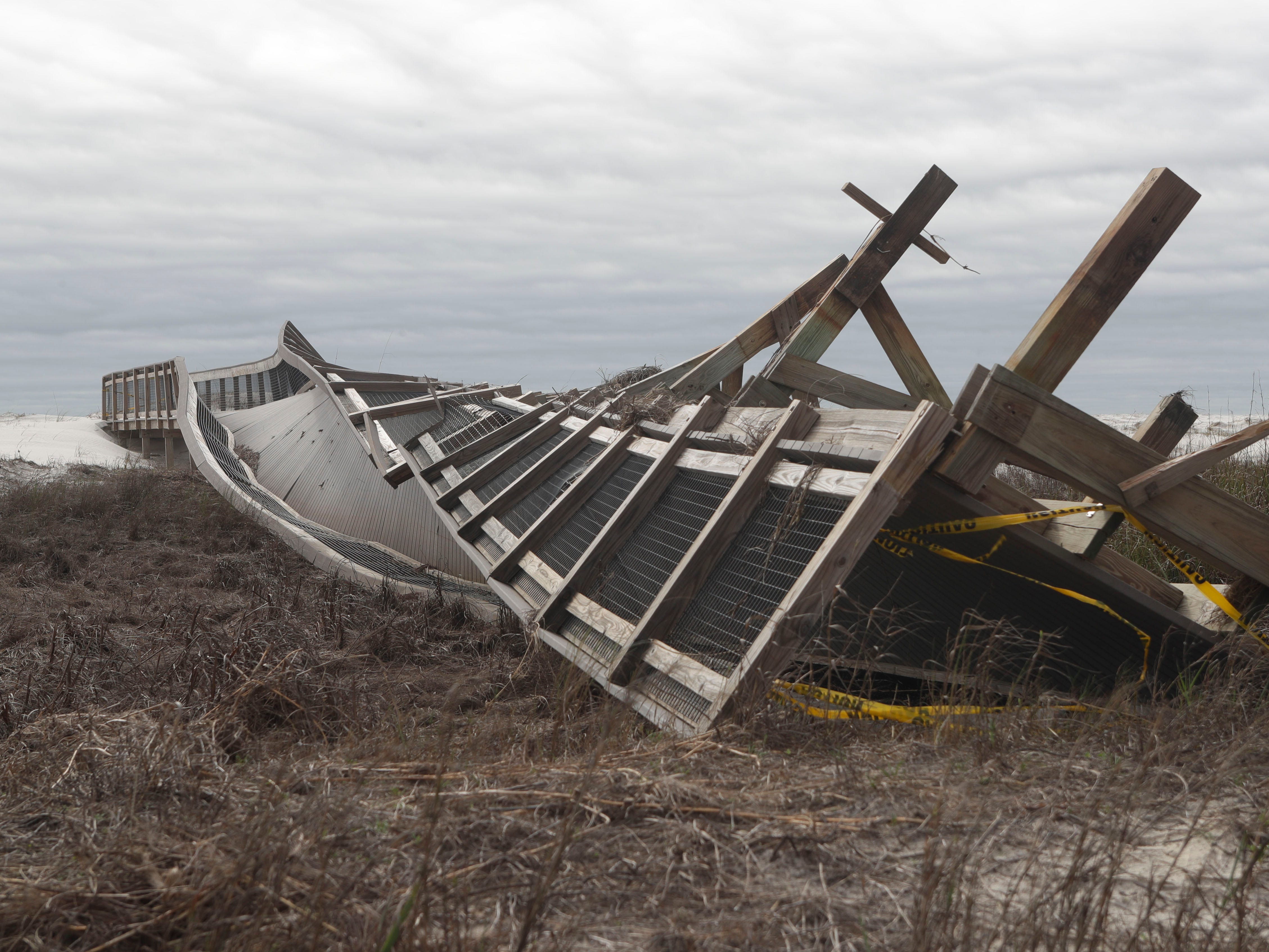 A boardwalk leading out to the beach in St. George Island State Park is now spiraled and unusable, Tuesday Feb. 19, 2019. The boardwalk was damaged by Hurricane Michal in Oct. 2018.