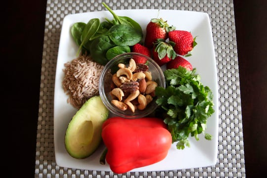 Heart healthy foods include berries, avocado, whole grains and leafy greens.