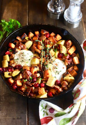 Start or end the day with Sweet Potato Hash, featuring Granny Smith apples, cranberries and bacon.eggs