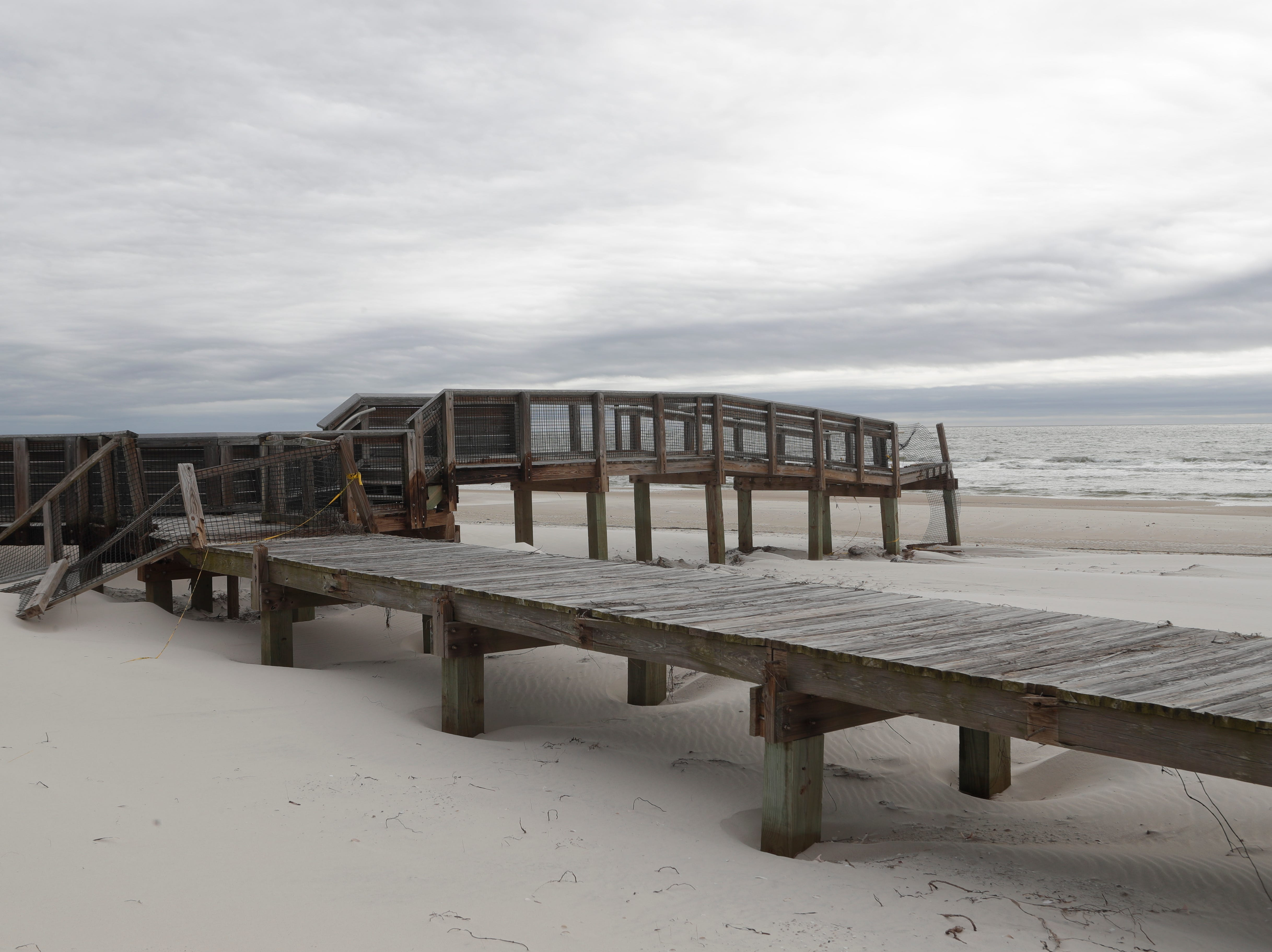 A boardwalk out to the beach from a pavilion in St. George Island State Park, Tuesday Feb. 19, 2019. The railings from the boardwalk were torn apart during Hurricane Michael in Oct. 2018.