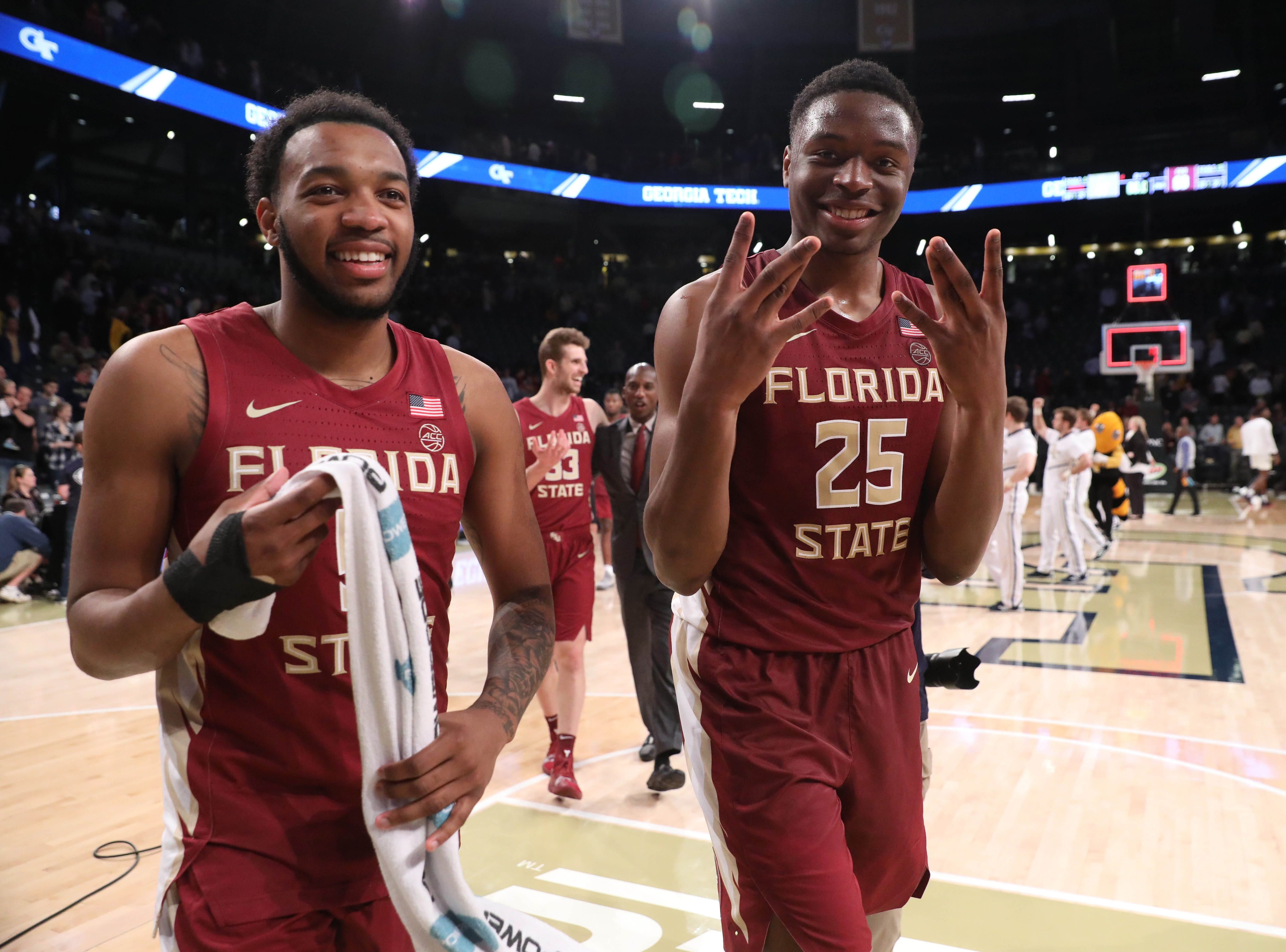 Feb 16, 2019; Atlanta, GA, USA; Florida State Seminoles guard PJ Savoy (5) and forward Mfiondu Kabengele (25) celebrate their win against the Georgia Tech Yellow Jackets at McCamish Pavilion. Mandatory Credit: Jason Getz-USA TODAY Sports
