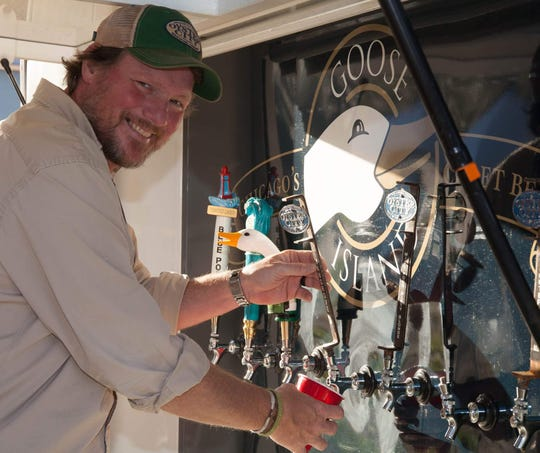 Bo Walker, co-owner of Oyster City Brewing Company, pours a beer during the inaugural Big Bend BrewFest last year in Perry. Oyster City will be one of the nearly 20 breweries featured there for the 2nd Annual event, which will be held March 2 at Rosehead Park.