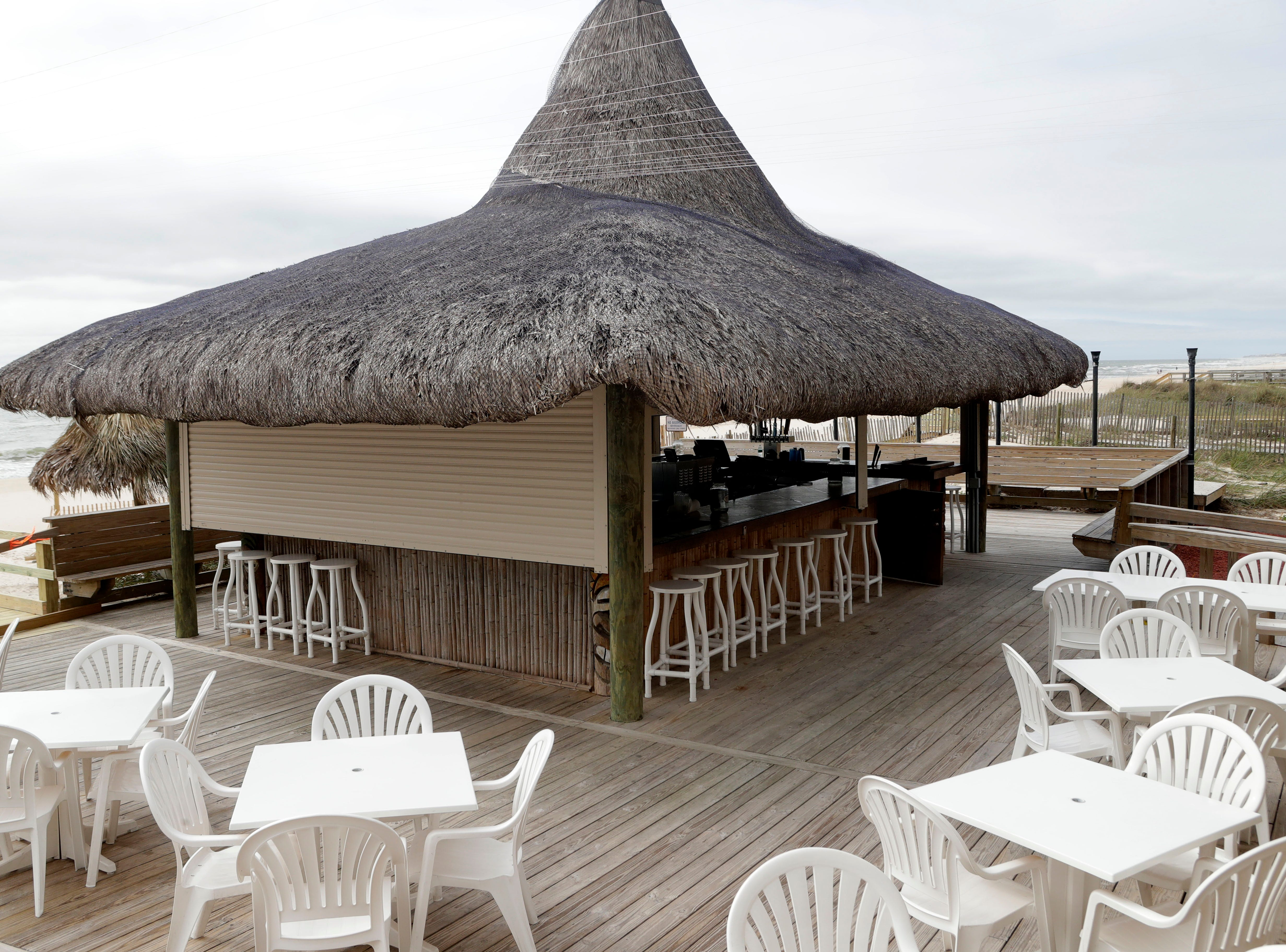 The tiki bar at Blue Parrot Ocean Front Cafe on St. George Island, Fla., looks just how it did before Hurricane Michael hit 5 months prior.