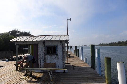 Chris Noonan, along with fellow volunteer Gary Donlin (not pictured), continue minor cosmetic repair work on the shack at the end of Jones Pier on Tuesday, Feb. 19, 2019, along Jungle Trail in Indian River County. The structure and pier were once used to load citrus grown on the island on to boats for transportation to other cities along the Indian River Lagoon. Indian River County officials are working with the Indian River County Historical Society to preserve the shack and the adjacent Jones homestead as a museum with educational programs, a walking trail and community garden.