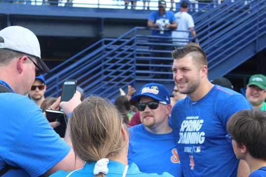 Tim Tebow has his picture taken with a Special Olympics Athlete on Sunday at First Data Field in Port St. Lucie.