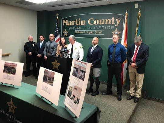 Officials attend a Martin County Sheriff's Office press conference.