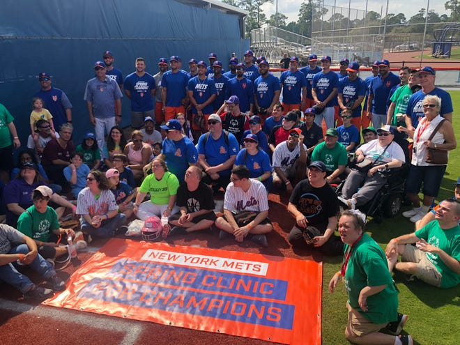 A group of Special Olympics athletes take a group picture with New York Mets players and coaches during the Spring Clinic For Champions at First Data Field in Port St. Lucie on Sunday.