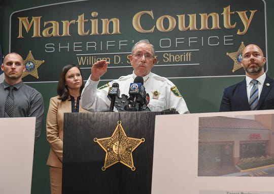 Martin County Sheriff William Snyder (center), along with (from left) Sgt. Josh Kloster, Martin County Sheriff's Office, Florida Attorney General Ashley Moody, and Congressman Brian Mast, are seen during a media briefing at the Martin County Sheriff's Office in Stuart on Tuesday, Feb. 19, 2019, to discuss an eight-month multi-agency case investigation involving human trafficking and prostitution. CQ: William Snyder, Josh Kloster, Ashley Moody, Brian Mast