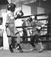 Osenohad Vazquez, 10, of Palm Bay ROUND13 Boxing spars with Jayden Carpenter, 10, of Future Worth Fighting 4 of Fort Pierce.