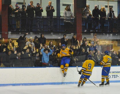 Mahopac captain T.J. McKee celebrates with schoolmates after knotting the score against Rye Town/Harrison in a Section 1 quarterfinal Monday Feb. 18, 2019 at Playland Ice Casino. He scored again some three minutes later to give the Indians a 6-5 win.