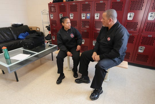 James Robinson and his daughter Nicole, 25, hold a pre-game meeting before the two refereed a boys high school basketball game at the Harvey School in Katonah Feb. 19, 2019. James Robinson has been a high school basketball referee for over thirty years. Nicole has followed in her father's footsteps, working as a referee for both high school and college basketball.