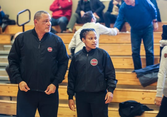 James Robinson and his daughter Nicole, 25, get ready to referee a boys high school basketball game at the Harvey School in Katonah Feb.19, 2019. James Robinson has been a high school basketball referee for over thirty years. Nicole has followed in her father's footsteps, working as a referee for both high school and college basketball.