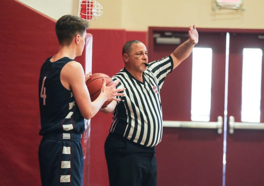 James Robinson referees a boys high school basketball game at the Harvey School in Katonah Feb.19, 2019. Robinson's fellow referee in the game was his daughter Nicole. James Robinson has been a high school basketball referee for over thirty years. Nicole has followed in her father's footsteps, working as a referee for both high school and college basketball.
