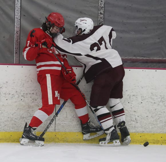 Darren Hilliard of North Rockland and Luke Schur of Scarsdale mix it up during a hockey playoff game at the Ice Hutch in Mount Vernon Feb. 18, 2019. North Rockland defeated Scarsdale 4-2.
