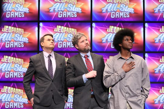 From left, Roger Craig, Austin Rogers and Leonard Cooper make up team Rogers on Jeopardy's Team Championship.