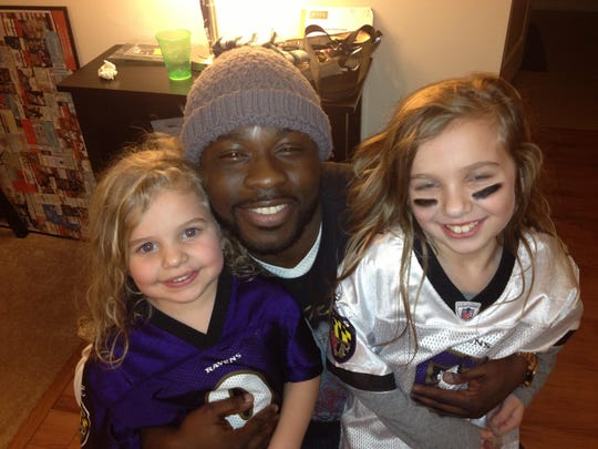 Frank Am with his friend Tim Harper's daughters.
