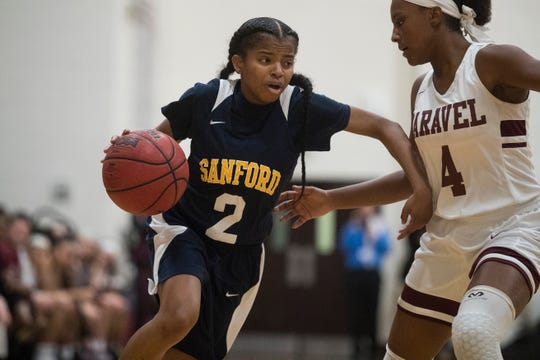 Sanford's Lauren Park (2) breaks inside against Caravel's Sasha Marvel Monday night. Sanford defeated Caravel Academy 64-42.