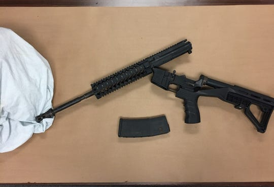 Dover police said they arrested 45-year-old Joseph Carter Monday for possession of an AR-15 with a bump stock attachment.