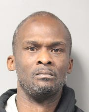 Joseph Carter, 45, of Dover, has been charged with possession of a firearm by a prohibited person; being a local fugitive; and possession of a destructive weapon, the bump stock attachment.