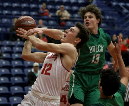 Holliday's Connor Cox is fouled by Breckenridge's Owen Woodward Monday, Feb. 18, 2019, in the Region I-3A bi-district playoff in Graham.