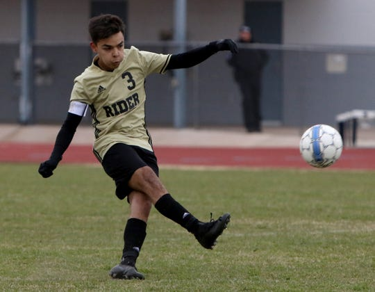 Rider's Trance Saenz passes in the match against Aledo Monday, Feb. 18, 2019, at Garnett Stadium. The Raiders defeated the Bearcats 2-1.