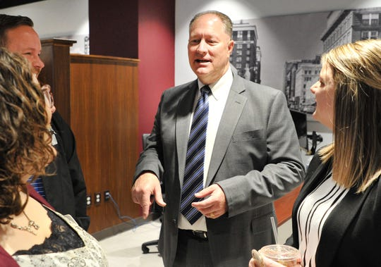 Texoma Community Credit Union, president & CEO, John Buckley chats after a ribbon cutting ceremony held to celebrate the official grand opening of their news downtown branch located on 8th Street Tuesday morning.