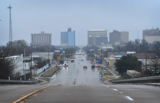 Tuesday afternoon downtown Wichita Falls was shrouded in a cold, gray mist as the forecast calls for a chance of widespread snow and ice.