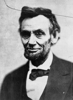 President Abraham Lincoln is shown on Feb. 5, 1865, in his last photo session.
