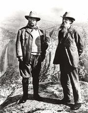 Hunter Teddy Roosevelt, left, and early conservationist John Muir stand on overlook at Glacier Point in Yosemite National Park.