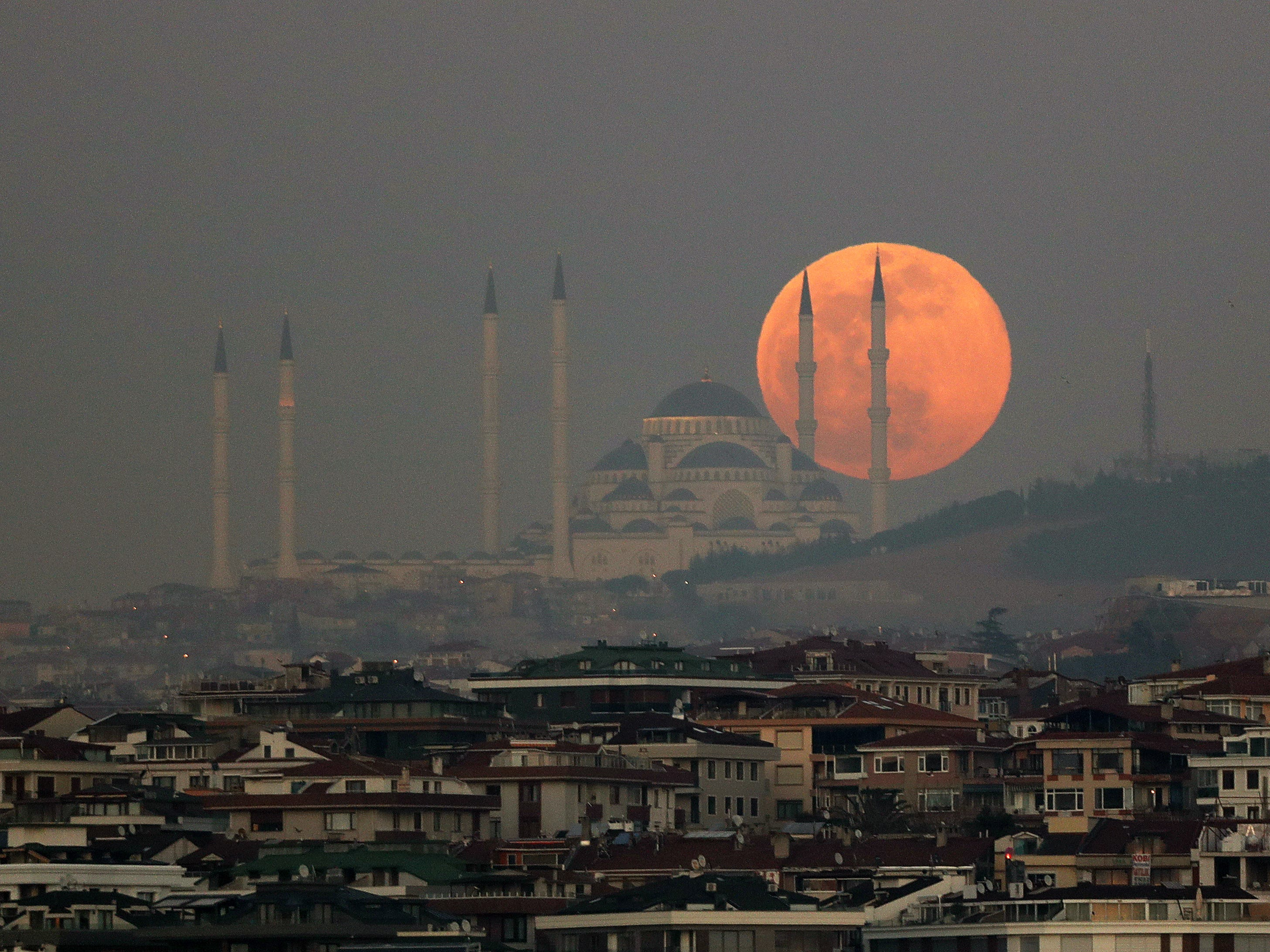 A supermoon rises behind the Camlica Mosque in Istanbul, Turkey on Feb. 19,  2019.
