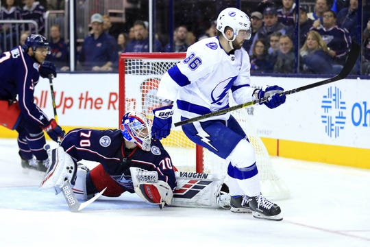 Tampa Bay Lightning right wing Nikita Kucherov (86) scores a goal against Columbus Blue Jackets goaltender Joonas Korpisalo (70) in the first period at Nationwide Arena.
