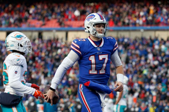 Bills quarterback Josh Allen (17) runs the ball in for a touchdown during the second half against the Miami Dolphins at New Era Field.