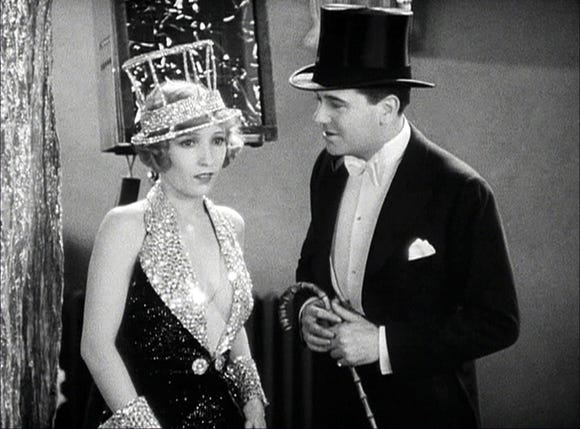 """Hank (Bessie Love) is part of a sister act that boyfriend Eddie (Charles King) wants to use in a new show in """"The Broadway Melody."""""""