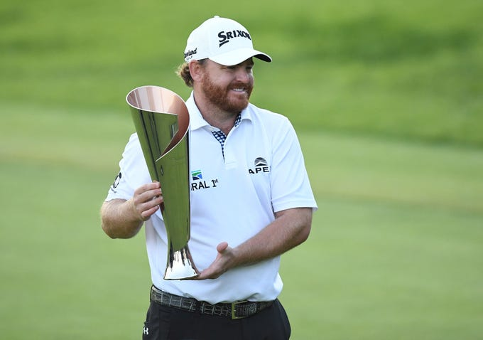 Feb. 17: J.B. Holmes poses with the winners trophy after his victory at the Genesis Open at Riviera Country Club in Pacific Palisades, California.