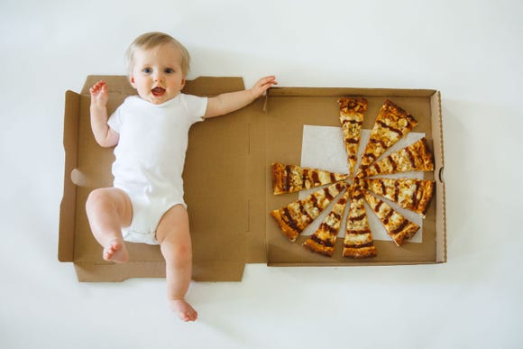 Baby Enzo at 9 months. His mother and professional photographer, Dani Giannandrea, marked his age each month by photographing how many pizza slices remained in the take out box.