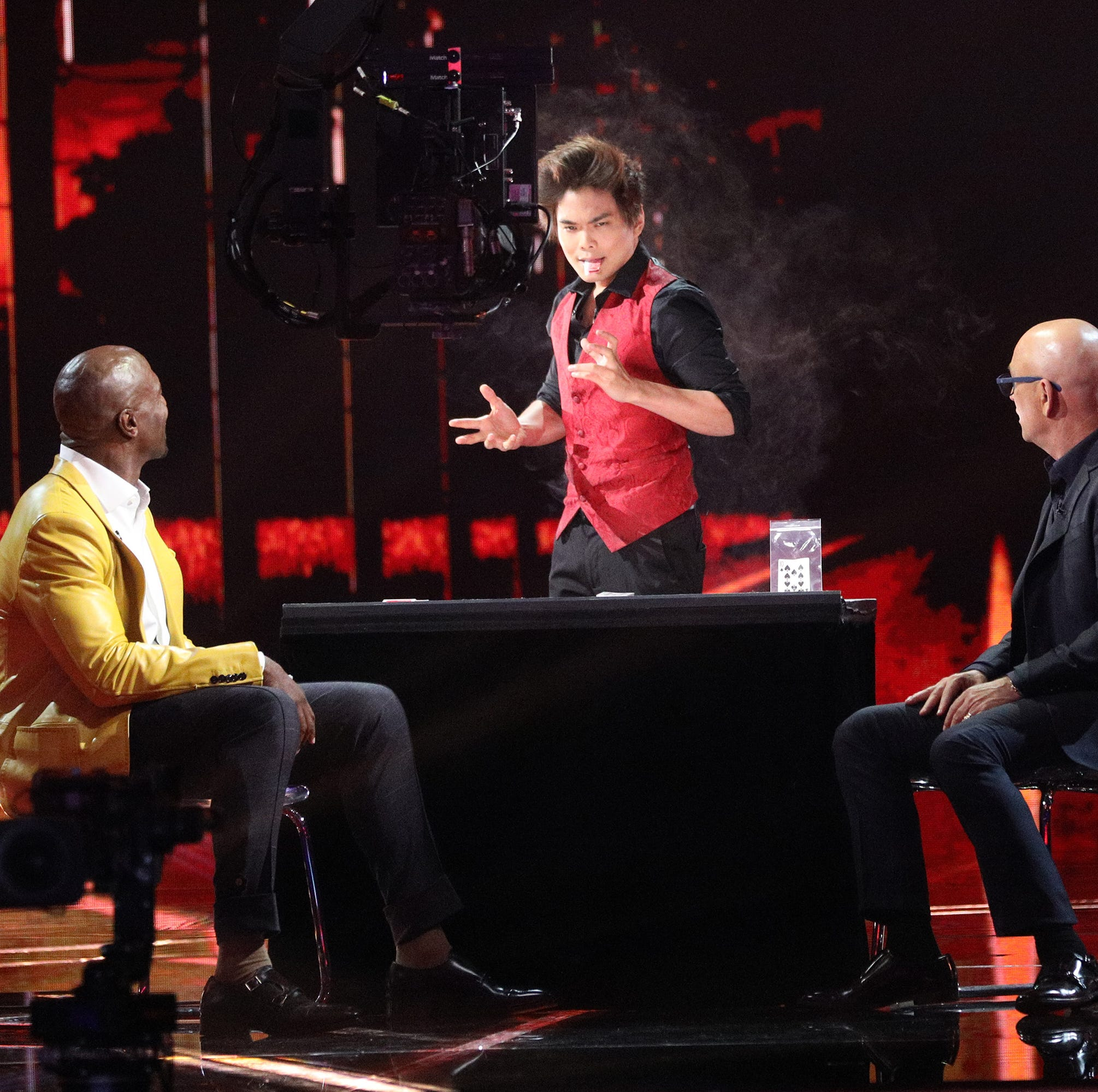Shin Lim, seen performing in the 'America's Got Talent: The Champions' finals in front of host Terry Crews, left, and judge Howie Mandel, won the special 'AGT' edition Monday.