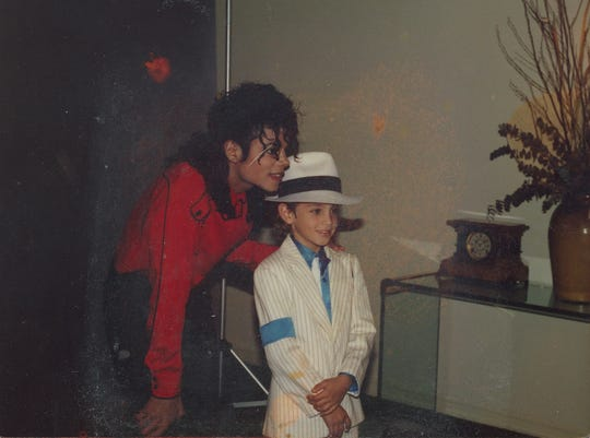 "Michael Jackson, left, with a young Wade Robson, who now claims the ""Thriller"" star sexually abused him for seven years."
