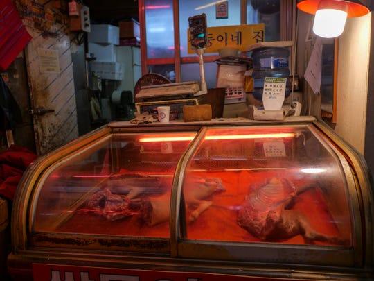A dog meat vendor in Gyeongdong Market, Seoul.