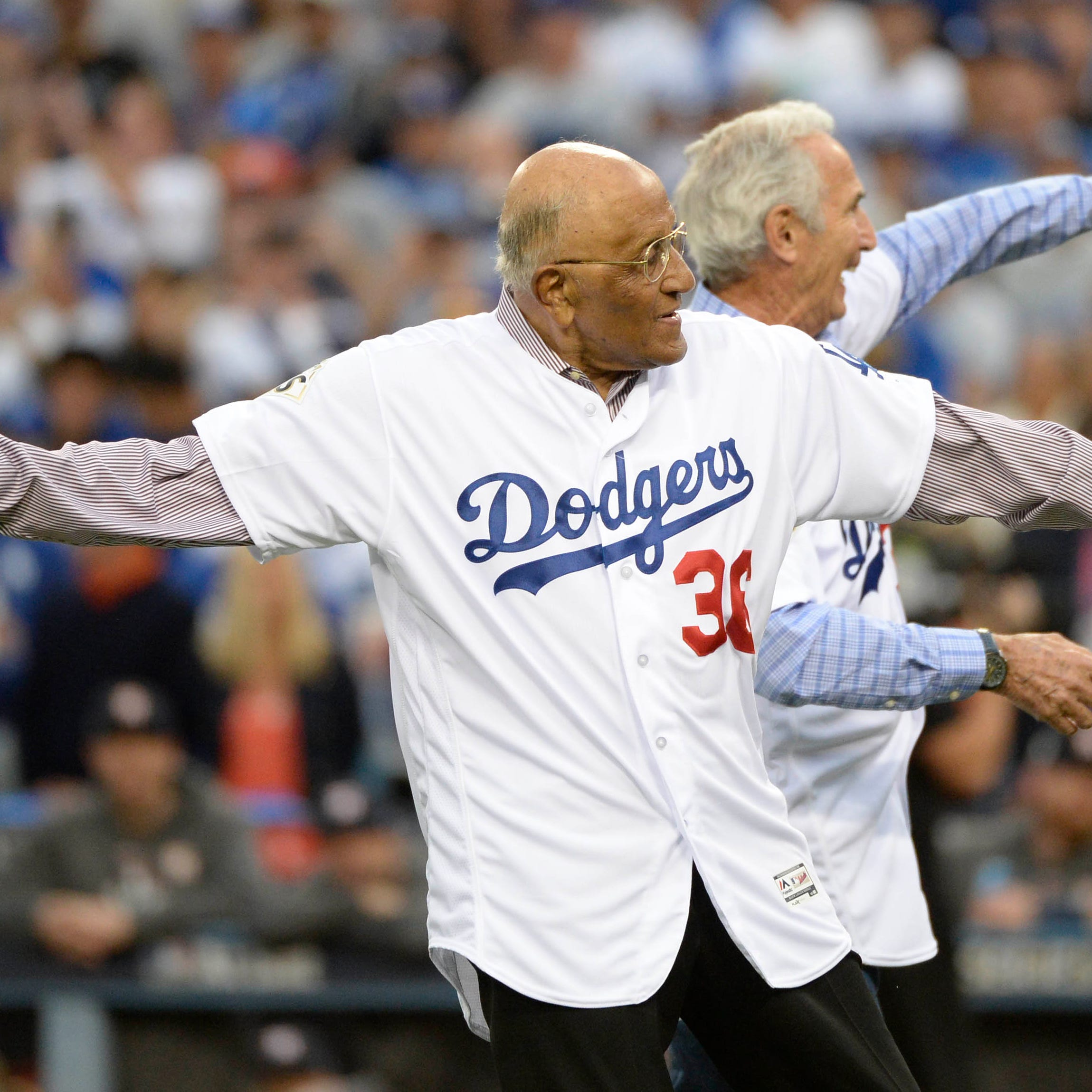 Los Angeles Dodgers former player Don Newcombe (36) throws with Sandy Koufax during Game 7 of the 2017 World Series against the Houston Astros at Dodger Stadium.
