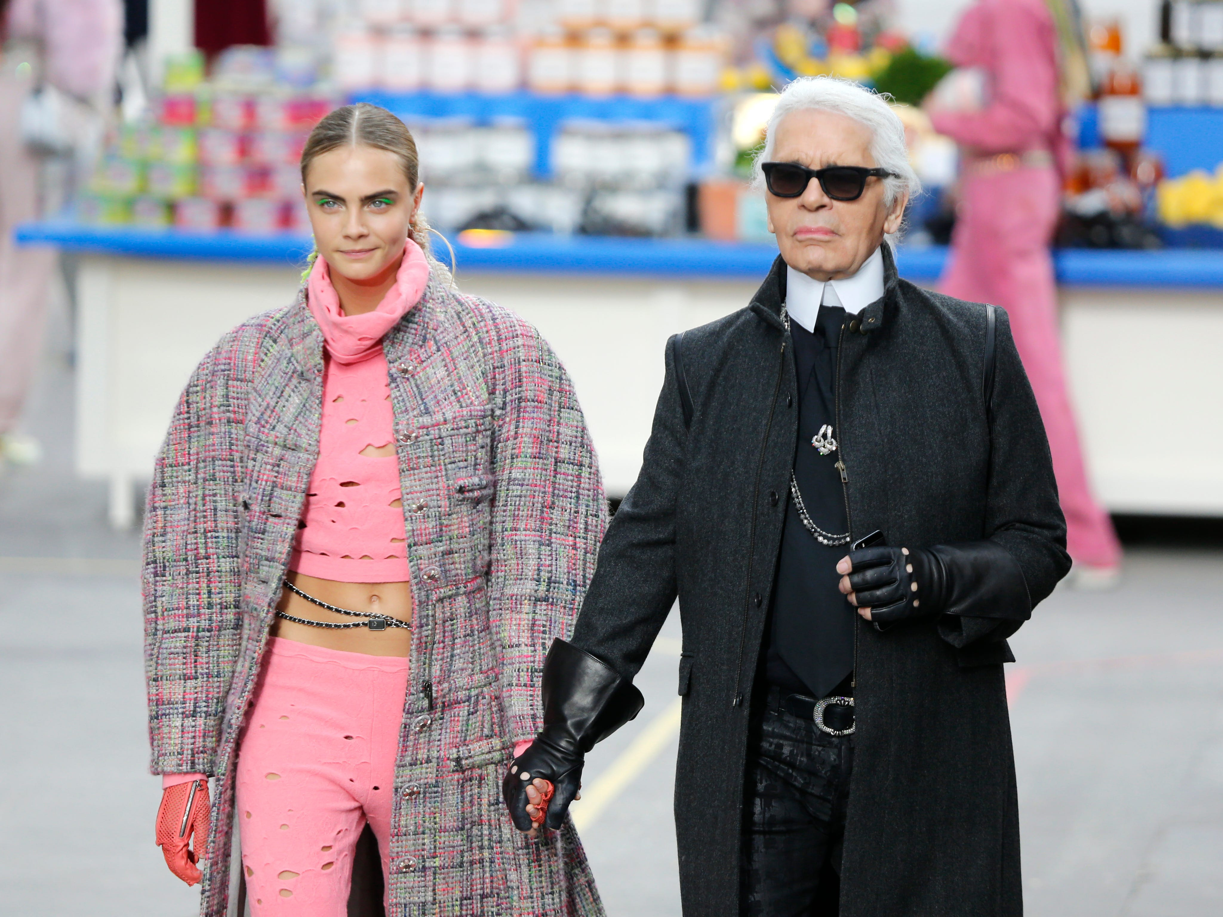 Cara Delevingne and Karl Lagerfeld pose at the presentation of Chanel's ready to wear fall/winter 2014-2015 fashion collection presented in Paris, March 4, 2014.