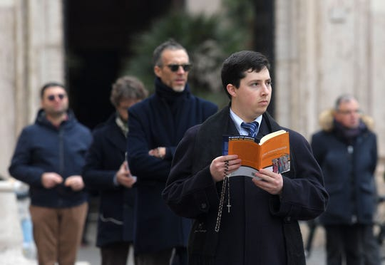 "Members of an international coalition of lay people known as ""Acies Ordinata"" hold a demonstration in Rome on Feb. 19, 2019, to denounce what they call a ""Wall of Silence"" regarding child sexual abuse within the Catholic Church."