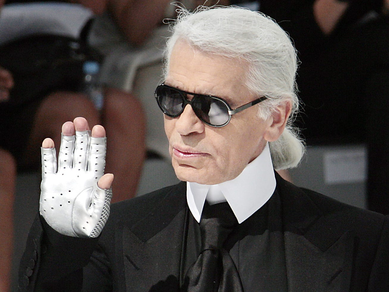 German designer Karl Lagerfeld acknowledges the public at the end Chanel Fall-Winter 2009 Haute Couture collection show in Paris on July 1, 2008. AFP PHOTO FRANCOIS GUILLOT (Photo by FRANCOIS GUILLOT / AFP)FRANCOIS GUILLOT/AFP/Getty Images ORG XMIT: - ORIG FILE ID: AFP_1DL9W1