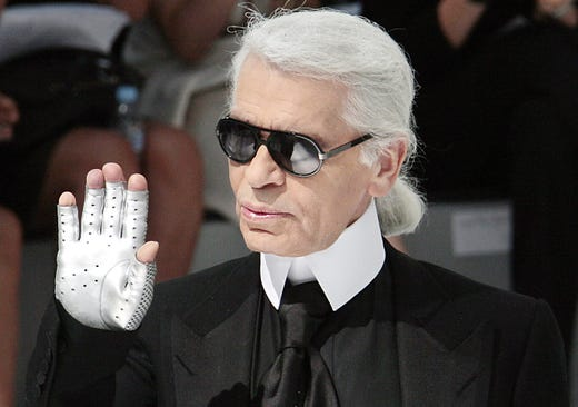 6e84fb7acf23 German designer Karl Lagerfeld acknowledges the public at the end Chanel  Fall-Winter 2009 Haute