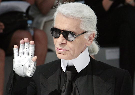 German designer Karl Lagerfeld acknowledges the public at the end Chanel Fall-Winter 2009 Haute Couture collection show in Paris on July 1, 2008.