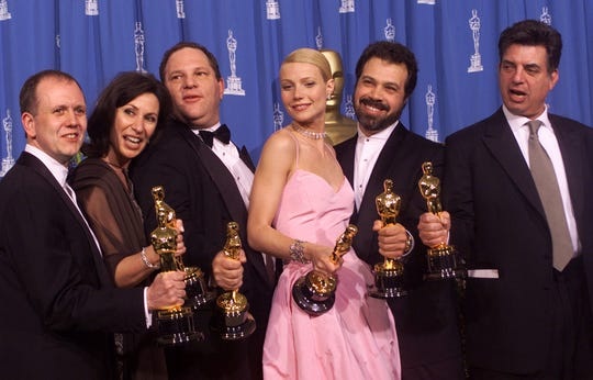"Paltrow, seen here celebrating the best-actress and best-picture wins for ""Shakespeare in Love"" at the 1999 Oscars with producer Harvey Weinstein, said he was a ""bully"" throughout their association."