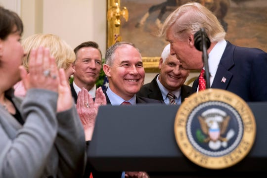 President Donald Trump, here in 2017 with former Environmental Protection Agency administrator Scott Pruitt, signed an order two years ago directing the EPA to withdraw from the Waters of the United States rule, which expanded the number of waterways protected under the Clean Water Act.