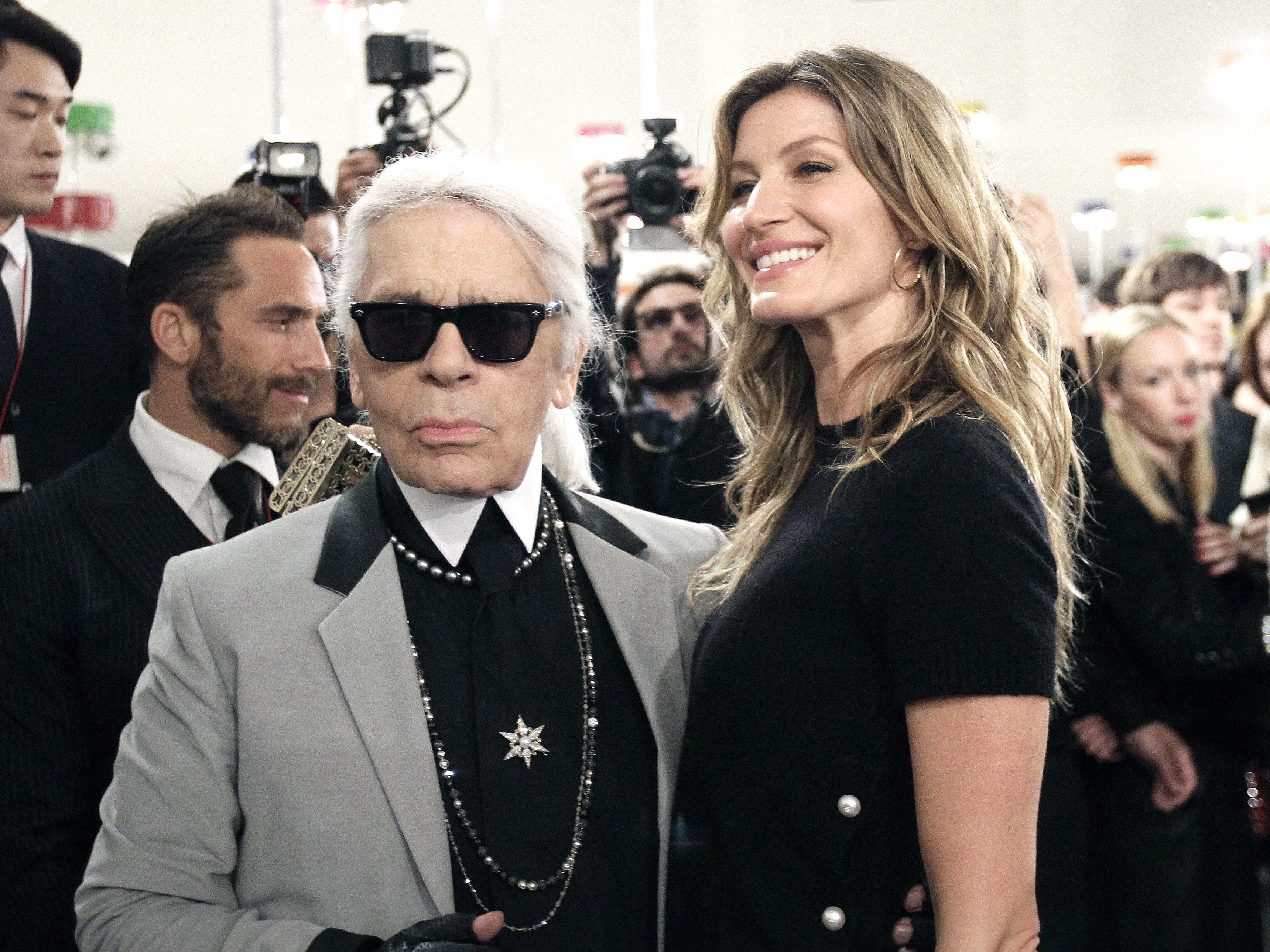 Karl Lagerfeld  poses with Gisele Bundchen after the presentation of his 2015-2016 Chanel cruise collection at the Dongdaemun Design Plaza in Seoul, South Korea,  May 4, 2015.