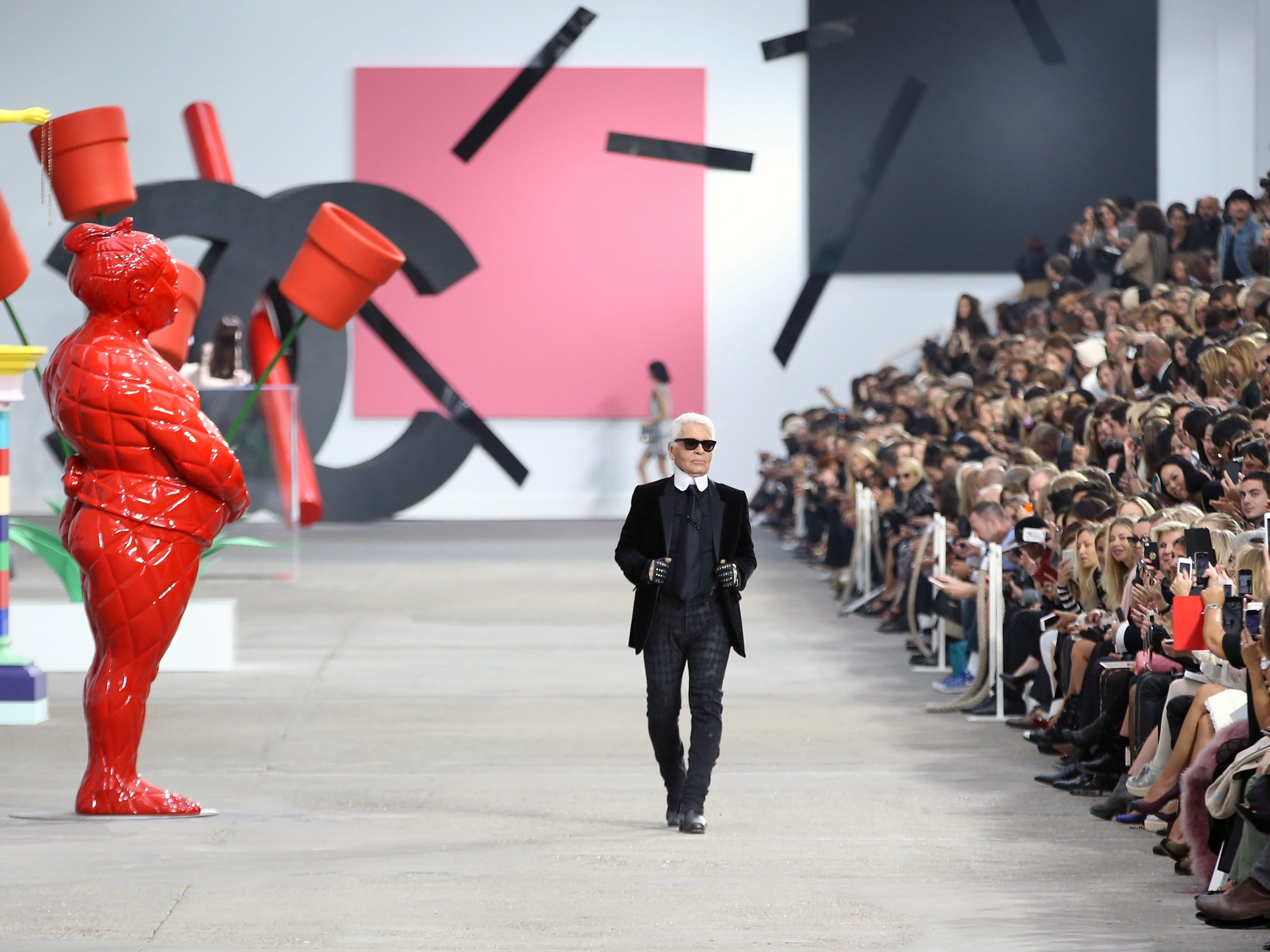Karl Lagerfeld takes to the catwalk at the end of the Chanel fashion show from the Spring/Summer 2014 Ready to Wear Collection during the Paris Fashion Week, in Paris, October 1, 2013.