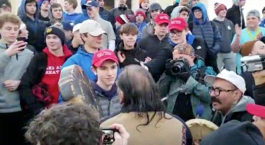 Covington Catholic High School student Nick Sandmann faces Native American Nathan Phillips in Washington on Jan. 18, 2019.