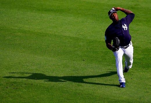 Feb. 19: Yankees closer Aroldis Chapman throws during a workout in Tampa.
